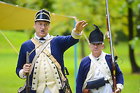 8/18/12 11:25:11 AM - Warwick, PA. -- John Godzieba of Langhorne, Pennsylvania demonstrates the use of a rifle during a revolutionary war reenactment at the Moland House August 18, 2012 in Warwick, Pennsylvania. -- (Photo by William Thomas Cain/Cain Images).