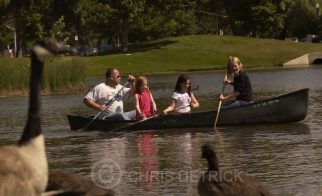Salt Lake City,Utah--7/2/2005- .FROM LEFT: Brad, Isabella, 6, Danielle, 9, and Mackenzie Knight, 11, canoe on the lake at LibertyPark Saturday afternoon..Pre 4th of July Festivities..Photo By: Chris Detrick /Salt Lake Tribune.File #DSC_4438