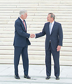 Chief Justice of the United States John G. Roberts, Jr., right, and Associate Justice of the Supreme Court of the United States Neil M. Gorsuch, left, shake hands after posing for photos on the front steps of the US Supreme Court Building after the investiture ceremony for Justice Gorsuch in Washington, DC on Thursday, June 15, 2017. <br /> Credit: Ron Sachs / CNP