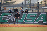 Umpire Larry Sorrell handles the duties down the first base line during the NCAA baseball game between the Akron Zips and the Charlotte 49ers at Hayes Stadium on February 22, 2015 in Charlotte, North Carolina.  The Zips defeated the 49ers 5-4.  (Brian Westerholt/Four Seam Images)