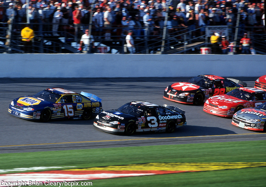 Dale Earnhardt and Michael Waltrip lead late in the 2001 Daytona 500 with the pack nipping at their heals. (Photo by Brian Cleary/www.bcpix.com)