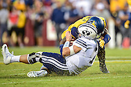 Landover, MD - SEPT 24, 2016: West Virginia Mountaineers cornerback Jake Long (11) with a big hit on BYU Cougars quarterback Taysom Hill (7) as he slides for a first down during their match up at FedEx Field in Landover, MD. (Photo by Phil Peters/Media Images International)