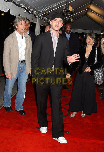 "JUSTIN TIMBERLAKE.Attends the ""Edison"" World Premiere held at Roy Thomson Hall during The Toronto Film Festival,.Toronto 17th September 2005.full length black baseball hat cap suit stubble trainers white hand wave waving palm.Ref: ADM/LF.www.capitalpictures.com.sales@capitalpictures.com.© Capital Pictures."