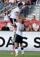 02 June 2013: U.S .Women's National Team player Abby Wambach #20 celebrates a goal by U.S. National Team Player Alex Morgan #13 during an international friendly soccer match between the U.S Women's National Team and the Canadian Women's National Team at BMO Field in Toronto, Ontario Canada.<br /> The U.S. National Women's Team won 3-0.