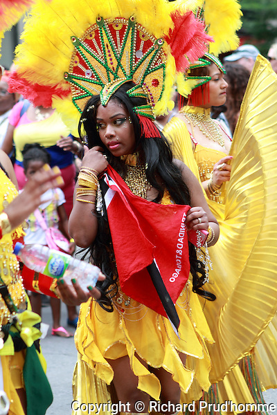 Females weraing colorful costumes for the annual Carifiesta parade held in downtown Montreal