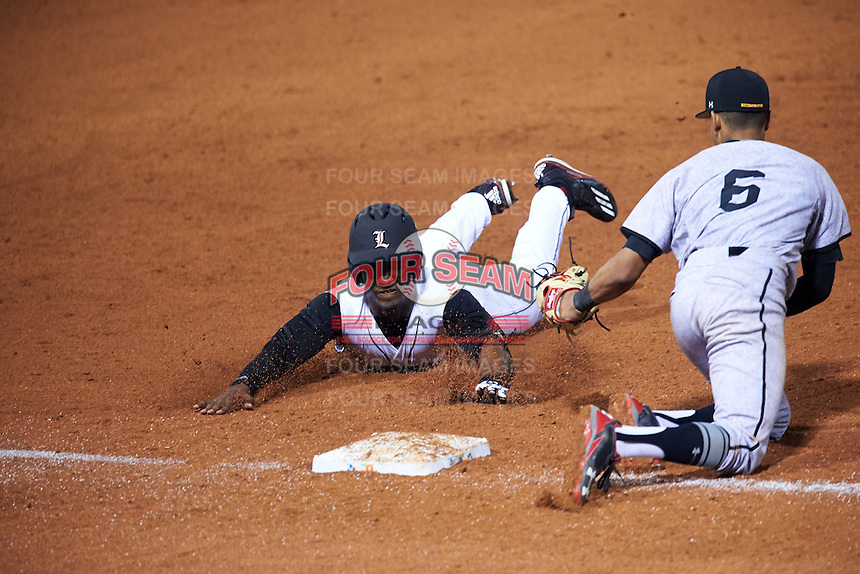 Louisville Cardinals left fielder Josh Stowers (25) slides safely into third as AJ Lee (6) looks to tag during a game against the Maryland Terrapins on February 18, 2017 at Spectrum Field in Clearwater, Florida.  Louisville defeated Maryland 10-7.  (Mike Janes/Four Seam Images)