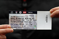 9th February 2020; The Den, London, England; English Championship Football, Millwall versus West Bromwich Albion; Match ticket held up by a Millwall fan