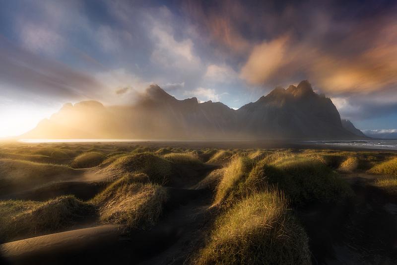 Soft light dancing across sand dunes on the Stokksnes Peninsula. Vestrahorn, Iceland