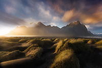 Soft light dancing across sand dunes on the Stokksnes Peninsula. Vestrahorn, Iceland