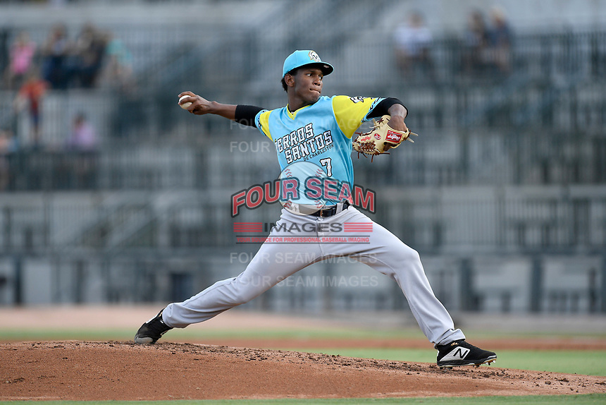Starting pitcher Roansy Contreras (7) of the Charleston RiverDogs, playing as the Perros Santos de Charleston, delivers a pitch in a game against the Columbia Fireflies on Friday, July 12, 2019 at Segra Park in Columbia, South Carolina. The RiverDogs won, 4-3, in 10 innings. (Tom Priddy/Four Seam Images)