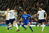 27th March 2018, Wembley Stadium, London, England; International Football Friendly, England versus Italy; Lorenzo Pellegrini of Italy takes on John Stones of England