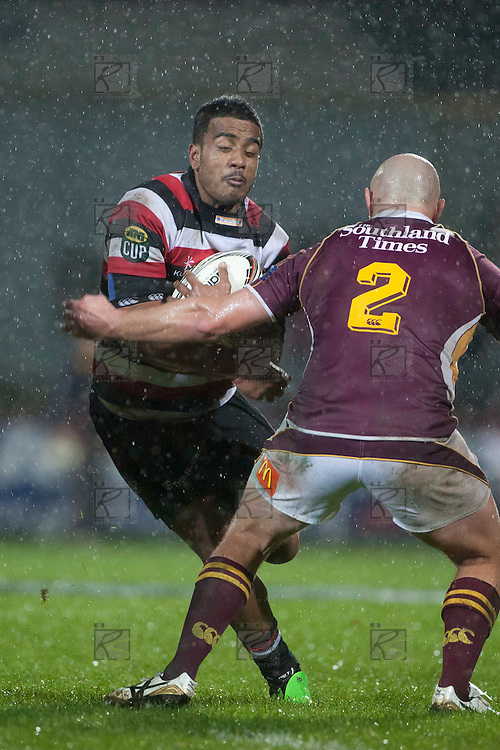 Reynold Lee-Lo braces for the tackle of David Hall. ITM Cup Round 4 and Ranfurly Shield rugby game between Counties Manukau Steelers and Southland, played at Rugby Park Invercargill, on Friday July 29th 2011..Southland won the game 22 - 14 after leading 13 - 6 at halftime.