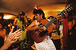 Negrita plays guitar at the Clarouset. An evening celebration during the Gypsy pilgrimage of Saintes Maries de la Mer. Camargue, France