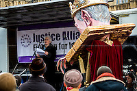 Michelle Bates (Sister of Barry George, wrongly convicted on 2 July 2001 of the murder of British television presenter Jill Dando).<br /> <br /> London, 23/02/2015. Today, the &quot;Justice Alliance&quot; and their Chris Grayling puppet dresses as King John Lackland arrived in Westminster for the last day of a tree-day march called &quot;Relay For Rights&quot; from Runnymede, birth place of the Magna Carta, to Old Palace Yard, where they held the &quot;Not the Global Law Summit&quot; rally. At the end of the demonstration outside the Houses of Parliament, protesters marched peacefully to the Queen Elizabeth II Centre where the &quot;Global Law Summit&quot; was taking place. From the organisers Facebook page: &lt;&lt; [&hellip;] February 23rd 2015 is the 799th and 8 month anniversary of the signing of the Magna Carta. The Government is using this non-anniversary to host the Global Law Summit, &quot;a unique opportunity to explore what the future holds for global business and the rule of law&quot;. This back-slapping corporate jamboree, partly funded by the Ministry of Justice, comes at a time when the same department has waged a slash-and-burn campaign on advice and representation, leaving people without deep pockets unable to get justice in court. Magna Carta represents the oldest historical commitment to equal access to justice in Britain. We are here to remind the Government of its duty to provide access to justice for all, and not merely to the rich. [&hellip;]&gt;&gt;<br /> <br /> For more information please click here: http://bit.ly/1G6aHZx