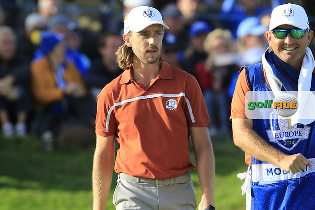 Tommy Fleetwood (Team Europe) sinks his putt on the 12th green during Saturday's Foursomes Matches at the 2018 Ryder Cup 2018, Le Golf National, Ile-de-France, France. 29/09/2018.<br /> Picture Eoin Clarke / Golffile.ie<br /> <br /> All photo usage must carry mandatory copyright credit (© Golffile | Eoin Clarke)