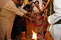 06.12.2008 Delhi(Harayana)<br /> <br /> Family members of the bride performing puja before the wedding day.<br /> <br /> Membres de la famille de la mariée realisant une puja avant le jour du mariage.