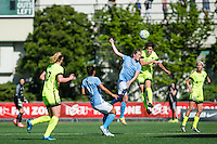 Seattle, WA - Sunday, April 17, 2016: Sky Blue FC midfielder Kelly Conheeney (24) goes up for a header against Seattle Reign FC midfielder Keelin Winters (11). Sky Blue FC defeated the Seattle Reign FC 2-1 during a National Women's Soccer League (NWSL) match at Memorial Stadium.