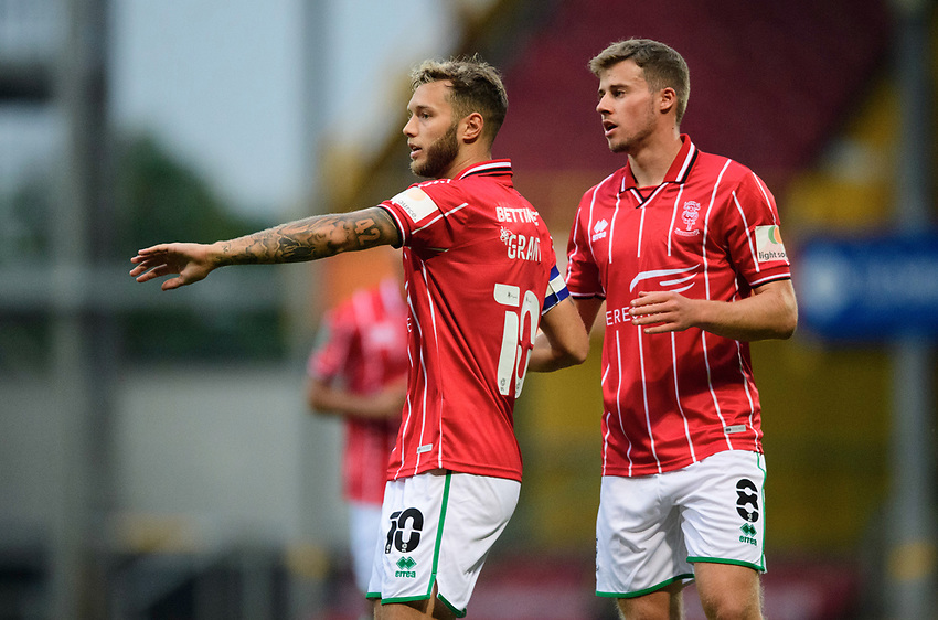 Lincoln City's Jorge Grant, left, celebrates with team-mate James Jones, after his free-kick was deflected into the goal by Bradford City's Tyler French to score the opening goal<br /> <br /> Photographer Chris Vaughan/CameraSport<br /> <br /> Carabao Cup Second Round Northern Section - Bradford City v Lincoln City - Tuesday 15th September 2020 - Valley Parade - Bradford<br />  <br /> World Copyright © 2020 CameraSport. All rights reserved. 43 Linden Ave. Countesthorpe. Leicester. England. LE8 5PG - Tel: +44 (0) 116 277 4147 - admin@camerasport.com - www.camerasport.com