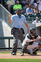 Home plate umpire Ryan Additon makes a strike call during the International League game between the Gwinnett Braves and the Charlotte Knights at BB&T BallPark on May 22, 2016 in Charlotte, North Carolina.  The Knights defeated the Braves 9-8 in 11 innings.  (Brian Westerholt/Four Seam Images)