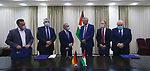 Palestinian Prime Minister Mohammad Shtayyeh, attends the signing of an agreement to support the sanitation sector in Salfit, in the West Bank city of Ramallah, on June 25, 2020. Photo by Prime Minister Office
