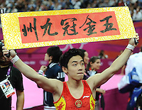 05.08.2012.  London, ENGLAND; Kai Zou of China celebrates during the medal ceremony following the Artistic Gymnastics Men's Floor Exercise final on Day 9 of the London 2012 Olympic Games at North Greenwich Arena.