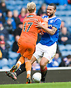 DUNDEE UTD'S GARY MACKAY STEVENS COLLIDES WITH RANGERS' KYLE BARTLEY
