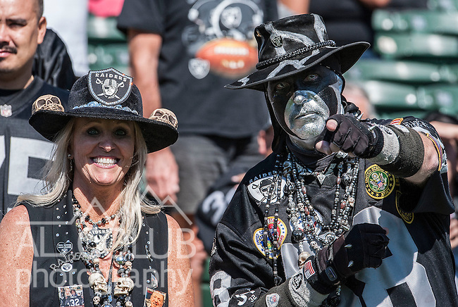 Oakland Raiders vs Detroit Lions at O.co Coliseum Saturday, August 25, 2012. Raiders defeated Lions 31-20 in a preseason game..Raider fan couple..