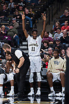 Melo Eggleston (11) of the Wake Forest Demon Deacons reacts to a teammate making a three-point shot during second half action against the Richmond Spiders at the LJVM Coliseum on December 2, 2017 in Winston-Salem, North Carolina.  The Demon Deacons defeated the Spiders 82-53.  (Brian Westerholt/Sports On Film)