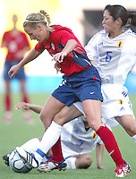 20 August 2004:    Kristine Lilly battles for the ball against Tomoe Sakai of Japan during the quarterfinals at Kaftanzoglio Stadium in Thessaloniki, Greece.     USA defeated Japan, 2-1 .   Credit: Michael Pimentel / ISI