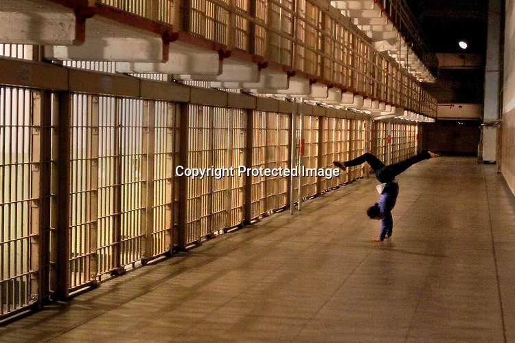 Alcatraz Island on a night tour with a hand stand.