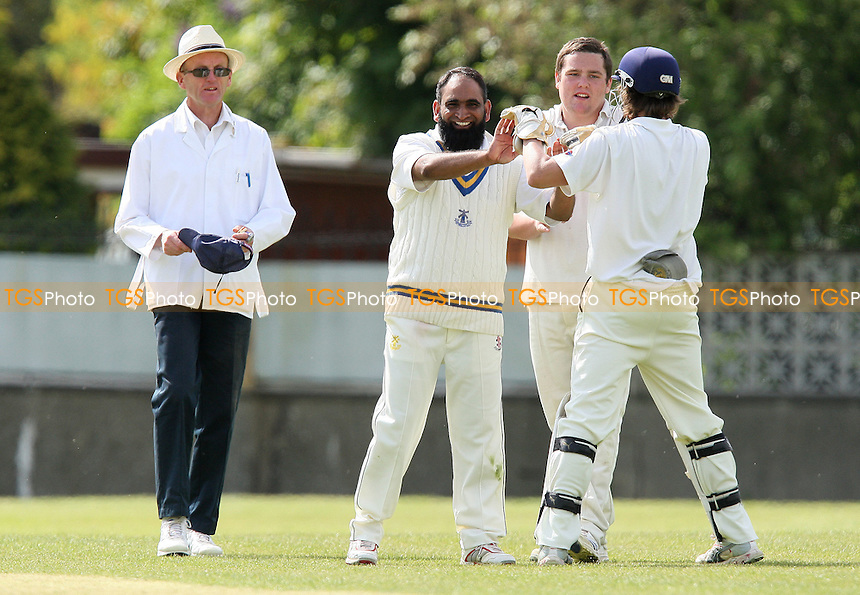 B Nathen of Wickford is dismissed, clean bowled by S Rahman (L) - Wickford CC vs Upminster CC - Essex Cricket League Cup - 02/05/09 - MANDATORY CREDIT: Gavin Ellis/TGSPHOTO - Self billing applies where appropriate - 0845 094 6026 - contact@tgsphoto.co.uk - NO UNPAID USE.