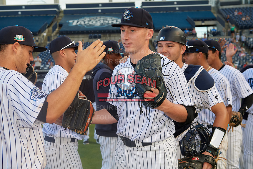 Tampa Tarpons pitcher Trevor Stephan (35) shakes hands with teammates, including Pablo Olivares (left), after closing out a Florida State League game against the Jupiter Hammerheads on July 26, 2019 at George M. Steinbrenner Field in Tampa, Florida.  Stephan struck out 9 batters over 7 innings for a no-hitter in the first game of a doubleheader.  Tampa defeated Jupiter 2-0.  (Mike Janes/Four Seam Images)
