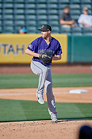 Mitch Horacek (33) of the Albuquerque Isotopes delivers a pitch to the plate against the Salt Lake Bees at Smith's Ballpark on April 27, 2019 in Salt Lake City, Utah. The Isotopes defeated the Bees 10-7. This was a makeup game from April 26, 2019 that was cancelled due to rain. (Stephen Smith/Four Seam Images)