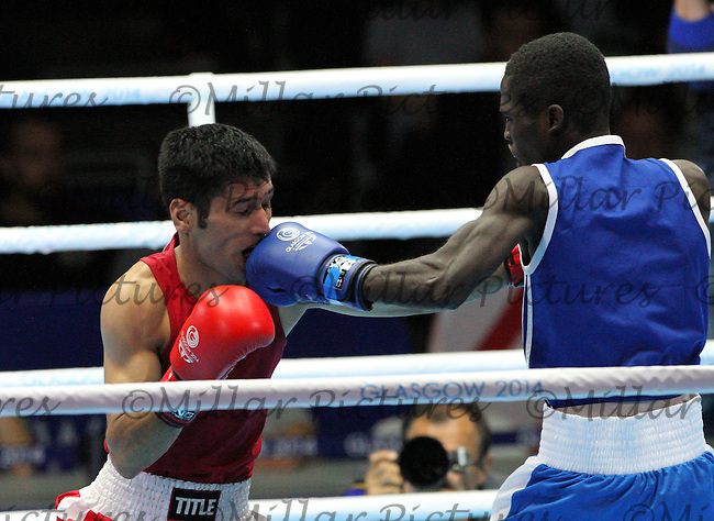 Muhammad Waseem of Team Pakistan in the red vest against Abdul Omar of Team Ghana in the Men's Flyweight Semi Final bout  in the Boxing for the 20th Commonwealth Games, Glasgow 2014 at the Scottish Exhibition and Conference Centre, Glasgow on 1.8.14.