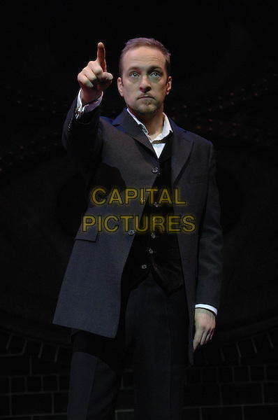 Derren Brown.On stage at the Shaftesbury Theatre, London ahead of the press night for Derren Brown: Svengali on Mon 10th June. London, England..June 9th, 2011.half length grey gray suit jacket black goatee facial hair hand arm pointing .CAP/WIZ.© Wizard/Capital Pictures.
