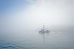 Fishing boat in morning fog, Stephens Passage, Southeast Alaska, USA