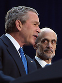 Washington, D.C. - March 3, 2005 -- United States Secretary of Homeland Security Michael Chertoff, right, takes a look at United States President George W. Bush, left, after taking the oath of office at the Ronald Reagan Building in Washington, DC on March 3, 2005.  <br /> Credit: Dennis Brack - Pool via CNP