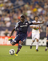 New England Revolution midfielder Joseph Niouky (23) shoots the ball. The New England Revolution defeated Monarcas Morelia in SuperLiga 2010 group stage match, 1-0, at Gillette Stadium on July 20, 2010.