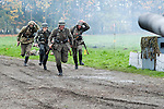 Re-enactors portrayiing panzer grenadiers run to take up positions during a battle battle re-enactment in on Pickering Showground<br /> <br /> 17/18 October 2015<br />  Image © Paul David Drabble <br />  www.pauldaviddrabble.co.uk