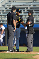 Bristol Pirates manager Miguel Perez (28) argues with umpires Thomas O'Neil (left) and Justin Juska after having been ejected from the game against the Danville Braves at American Legion Post 325 Field on July 1, 2018 in Danville, Virginia. The Braves defeated the Pirates 3-2 in 10 innings. (Brian Westerholt/Four Seam Images)