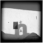July 1996 -- Mykonos, Greek Islands -- A reflection of a church bell on the home of a Greek family. .Andrew Kaufman©1996