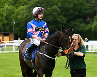 Simply Breathless and Sam Hitchcott are led into the winners enclosure after winning The Bathwick Tyres Novice Auction Stakes(plus 10, Div 2), during Afternoon Racing at Salisbury Racecourse on 13th June 2017