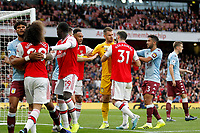 Arsenal players surround Thomas Heaton of Aston Villa during the Premier League match between Arsenal and Aston Villa at the Emirates Stadium, London, England on 22 September 2019. Photo by Carlton Myrie / PRiME Media Images.