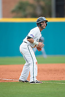 Anthony Marks (29) of the Coastal Carolina Chanticleers takes his lead off of third base against the Bryant Bulldogs at Springs Brooks Stadium on March 13, 2015 in Charlotte, North Carolina.  The Chanticleers defeated the Bulldogs 7-2.  (Brian Westerholt/Four Seam Images)
