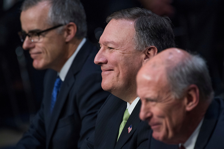 "UNITED STATES - MAY 11: From left, Acting FBI Director Andrew McCabe, CIA Director Mike Pompeo, and Director of National Intelligence Daniel Coats, appear during a Senate (Select) Intelligence Committee hearing in Hart Building titled ""World Wide Threats"" on May 11, 2017. (Photo By Tom Williams/CQ Roll Call)"