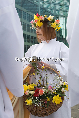 Druids perform a Spring Equinox ceremony at Tower Hill London. UK Annually March.