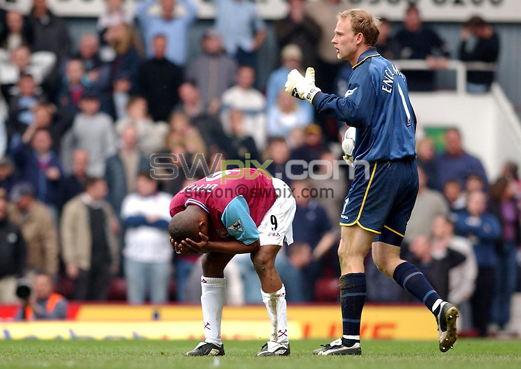 Pix:Daniel Hambury/SWpix.com. Football. Barclaycard Premiership. West Ham v Aston Villa. 12/04/03..COPYRIGHT PICTURE>>SIMON WILKINSON>>01943 436649>>..West Ham's Jermaine Defoe despairs after a late miss