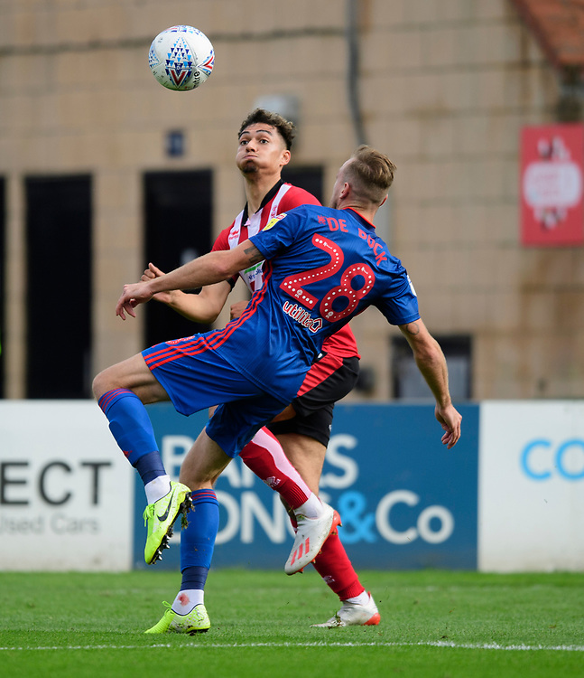 Lincoln City's Tyler Walker vies for possession with Sunderland's Laurens De Bock<br /> <br /> Photographer Chris Vaughan/CameraSport<br /> <br /> The EFL Sky Bet League One - Lincoln City v Sunderland - Saturday 5th October 2019 - Sincil Bank - Lincoln<br /> <br /> World Copyright © 2019 CameraSport. All rights reserved. 43 Linden Ave. Countesthorpe. Leicester. England. LE8 5PG - Tel: +44 (0) 116 277 4147 - admin@camerasport.com - www.camerasport.com