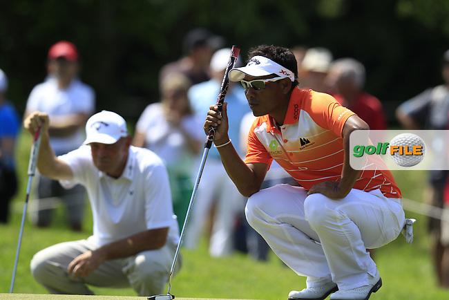 Thongchai Jaidee (THA) and Thomas Bjorn (DEN) line up their putts on the 8th green during Friday's Round 2 of the 2013 BMW International Open held on the Eichenried Golf Club, Munich, Germany. 21st June 2013<br /> (Picture: Eoin Clarke www.golffile.ie)