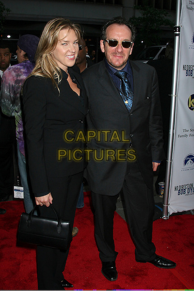 "DIANA KRALL & EVLIS COSTELLO .Arrivals At ""no Direction Home: Bob Dylan"" Premiere held at the Ziegfeld Theatre,.New York, 19th September 2005 .full length black suit sunglasses beard wife husband.Ref: IW.www.capitalpictures.com.sales@capitalpictures.com.©Capital Pictures"
